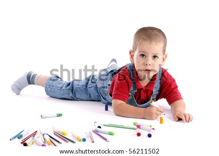 adorable little boy drawing whit colored pencil - stock photo