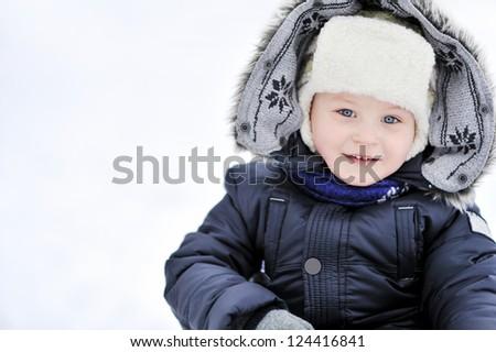 Adorable little boy in winter - closeup - stock photo
