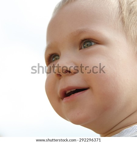 Adorable little boy playing on a playground - stock photo