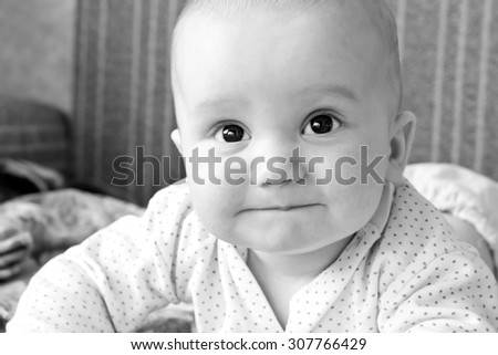 Adorable little boy smiling portrait. Looking up. Image toned in black and white colors - stock photo