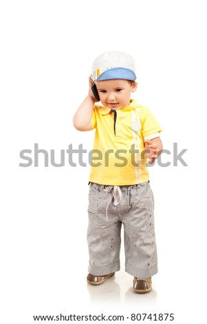 Adorable little boy talking at the mobile phone - stock photo