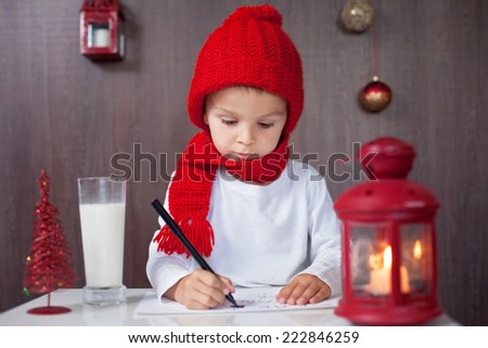 Adorable little boy, writing letter to Santa - stock photo