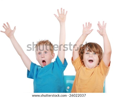 adorable little boys relaxing on a sofa couch - stock photo