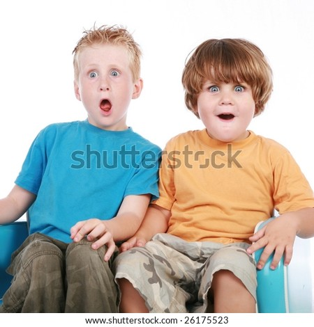 adorable little boys relaxing on a sofa couch