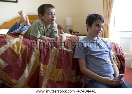Adorable little boys watching TV - stock photo