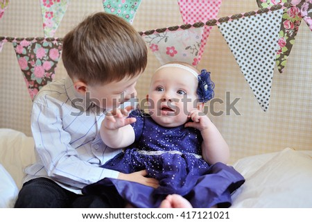 Adorable little brother and sister playing together - stock photo