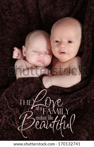 Adorable little brother and Sister twins together - stock photo