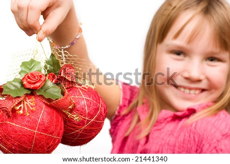 Adorable little child holding christmas decoration - stock photo
