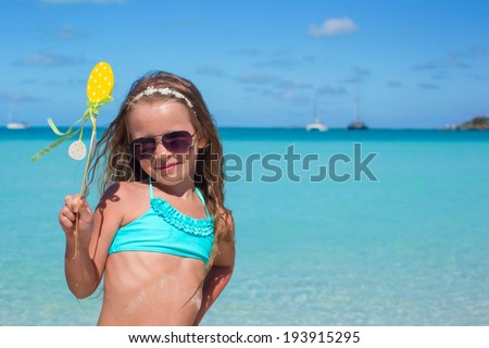 Adorable little girl at white beach during summer vacation - stock photo