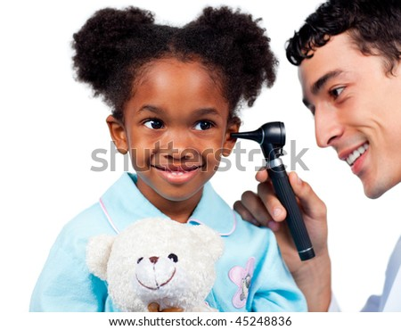 Adorable little girl attending medical check-up isolated on a white background - stock photo