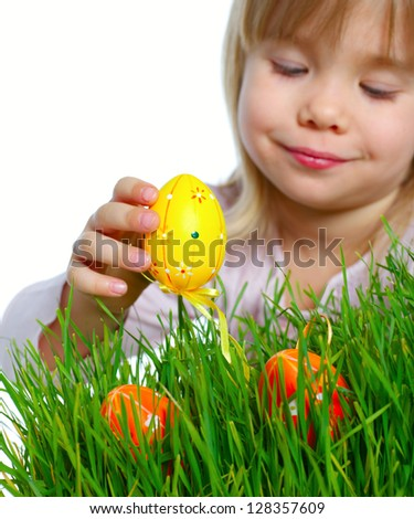 Adorable little girl collecting Easter eggs in her basket. Focus on the egg. Isolated white backround - stock photo
