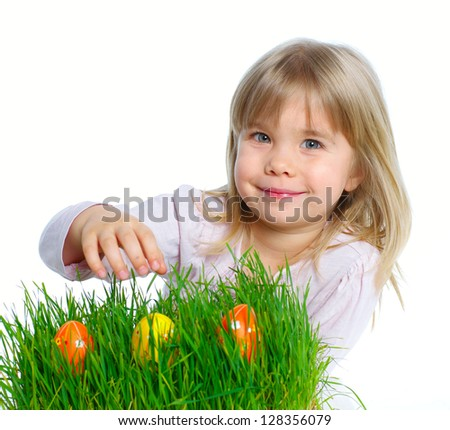 Adorable little girl collecting Easter eggs in her basket. Isolated white backround - stock photo