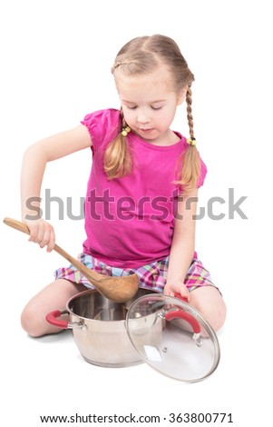 Adorable little girl cooking. isolated on white background - stock photo