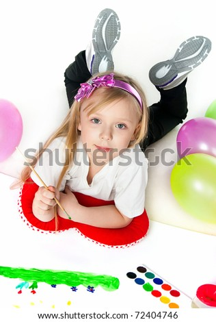 Adorable little girl drawing artwork. Studio shot