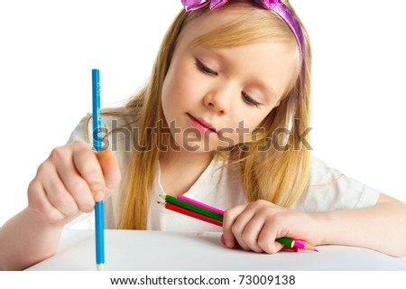 Adorable little girl drawing artwork. Studio shot - stock photo