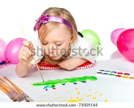 Adorable little girl drawing artwork. Studio shot - stock photo