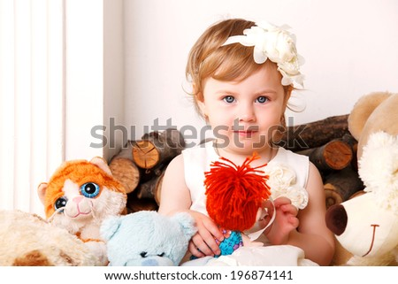 Adorable little girl dressed as a ballerina in a tutu, crown of roses