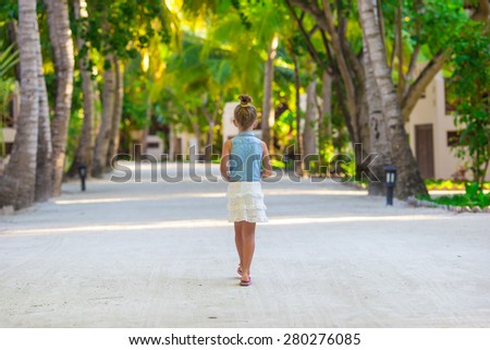 Adorable little girl during beach vacation - stock photo