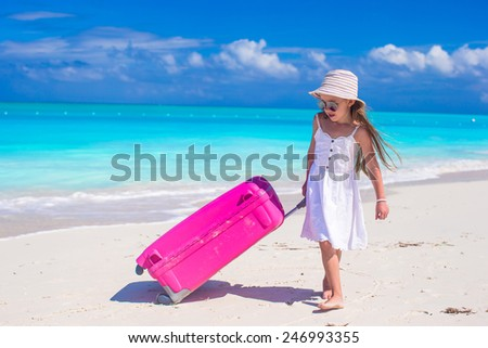 Adorable little girl during beach vacation have fun - stock photo