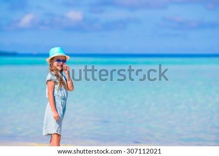 Adorable little girl during beach vacation having fun - stock photo