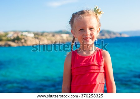 Adorable little girl during summer vacation at Sardinia, Spain - stock photo