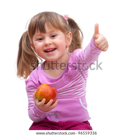 adorable little girl eating an apple and show good sign, isolated against white background - stock photo