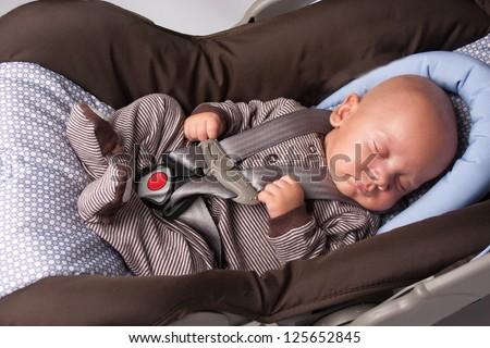 Adorable Little Girl Eating Yogurt  Baby Boy Sleeping In Safety Seat - stock photo