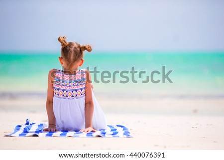 Adorable little girl enjoy beach summer vacation - stock photo