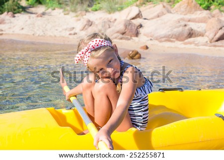 Adorable little girl enjoy kayaking during summer vacation - stock photo