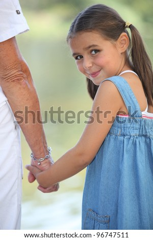 adorable little girl gone for a walk with grandma - stock photo
