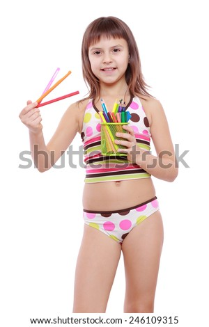 adorable little girl holding colorful pencils  - stock photo