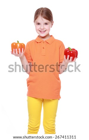 adorable little girl holding sweet pepper/Little girl playing with a big paprika, isolated on white - stock photo