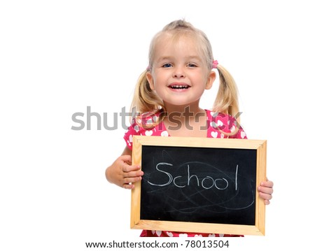 adorable little girl holds chalkboard that says school, isolated on white