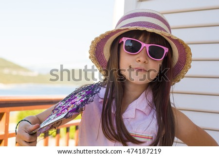 Adorable little girl in glases