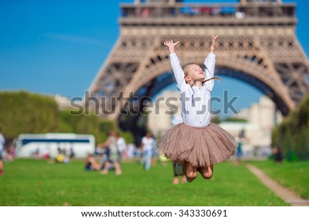 Adorable little girl in Paris background the Eiffel tower during summer vacation - stock photo