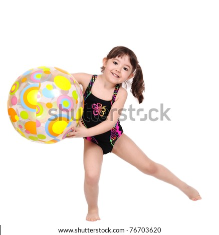 adorable little girl in swimsuit playing with colourful beach ball. isolated on white - stock photo