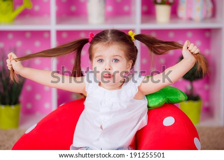 Adorable little girl in the nursery. emotions, fun, smile - stock photo