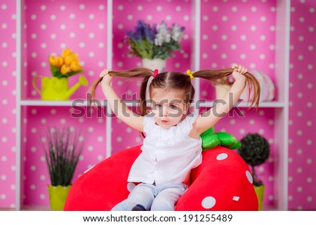 Adorable little girl in the nursery. emotions, fun, smile, children's world - stock photo