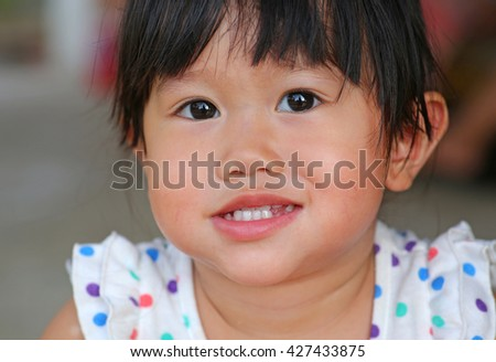 Adorable little girl is smile - stock photo