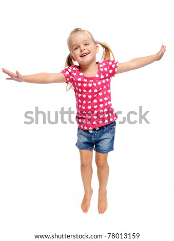 adorable little girl jumps in studio, having fun, isolated on white. - stock photo