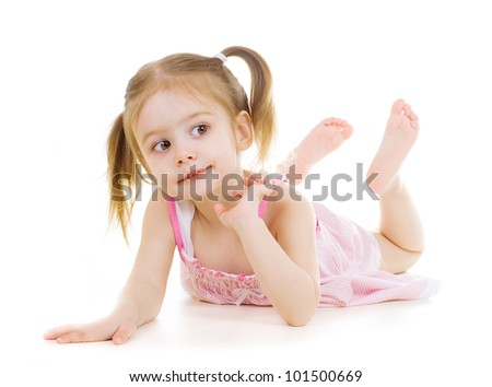 Adorable little girl laying on the floor and looking right  on white background - stock photo