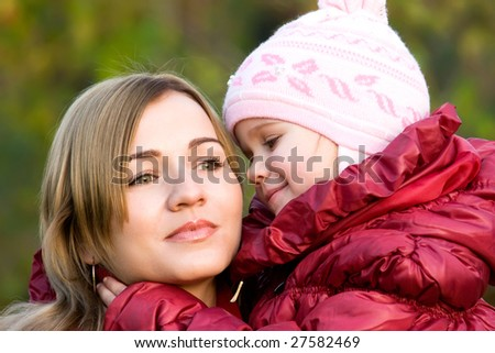 Adorable little girl looking at her mother with eyes full of love