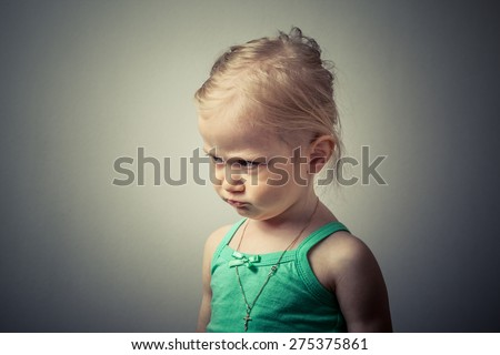 Adorable little girl making sad face. - stock photo