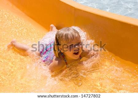 Adorable Little Girl on Waterslide - stock photo