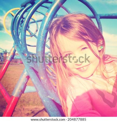 Adorable little girl outdoors in Summer instagram effect - stock photo