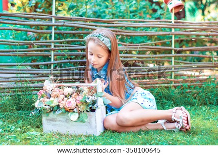 Adorable little girl outdoors in the yard - stock photo