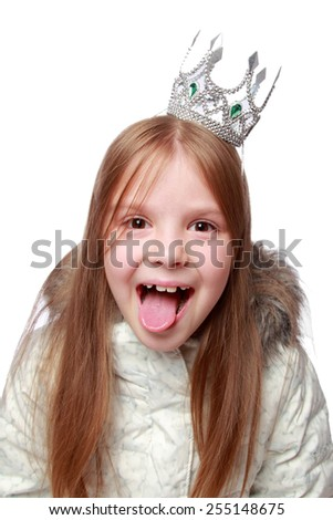 Adorable little girl princess hamming to the camera on a white background - stock photo