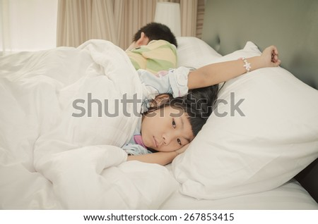 Adorable little girl relaxing on bed. - stock photo