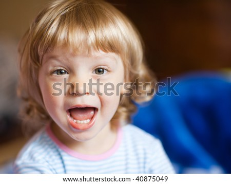 Adorable little girl - shallow DOF, focus on eyes - stock photo