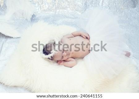 Adorable little girl sleeping - stock photo